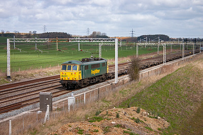 Class 86 locos are becoming rare and are only operated by Freightliner, 86501 is the only member of the sub class and is employed on 4L97 0710 Trafford Park to Felixstowe North Yard Freightliner.