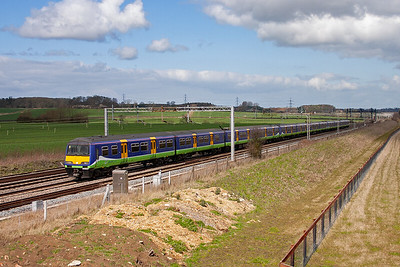 A 3 unit formation of class 321 EMU's give a 12 vehicle train running north to Northampton from Euston, 2N69 1124 off Euston.