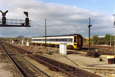 An Alphaline branded class 158 express sprinter arrives at Westbury. 158824 is working the 0703 Portsmouth Harbour to Cardiff Central service.