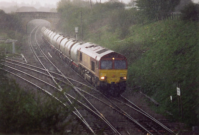 During one of many heavy thunderous downpours of rain and hailstones, 66003 passes Hawkeridge Junction with a rake of loaded TTA tanks of gas oil bound for St Philips Marsh depot, 6V62 1032 off Fawley Refinery.  Quite a contrast to the shot of 150251 taken a short while beforehand.