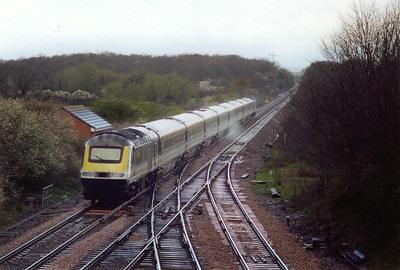 The rear powercar of 1C31 1033 Paddington to Penzance is not known as the set speeds over the pointwork of Fairwood Junction coming off the avoiding line. The original GWR signalbox stood to the right of the turnouts.