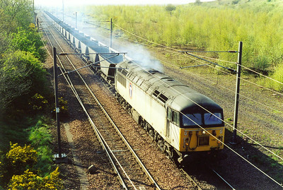 This short period of Grid mania sees 56132 head away from Millerhill with an early running 6C14, due off at 0953 to Ravenstruther. The loco is in two tone grey with Transrail branding and hauls a rake of empty HAA coal hoppers for loading.