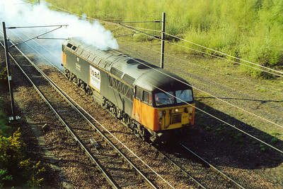 Loadhaul 56077 makes a smokey departure from Millerhill for an unknown destination.