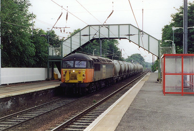 56107 is seen again with its cement tanks. They have been emptied and it is returning them to Oxwellmains for refilling. The train ID is 6B86 1945 from Viewpark near Glasgow to Oxwellmains to the south of Dunbar.