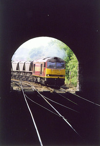 An unusual view of 60042 taken from the platform of the long abandoned Craiglockart station looking through the 60 yard long Craiglocklart Tunnel below the road and Union Canal to the junction. The working is 7B58 1530 from Ravenstruther to Millerhill loaded MGR.
