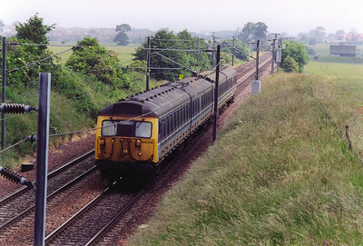 The North Berwick branch was worked at the time by elderly class 305 EMU's seeing out their days shuttling back and forth. 305508 heads for Edinburgh with a class 2 local 2Y09 1020 from North Berwick.