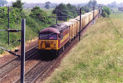 Out on the ECML just by the village of Inveresk and EWS liveried 56059 heads back to Powderhall with the empty binliner, 6B44 1053 from Oxwellmains to Powderhall.