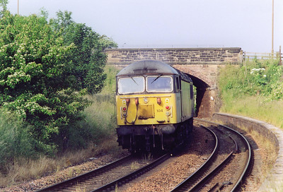 The closed station of Duddingston on the Edinburgh Suburban line is the location for 56104 passing through the platforms. All is not what it seems as the loco is dead and being towed by a class 60.