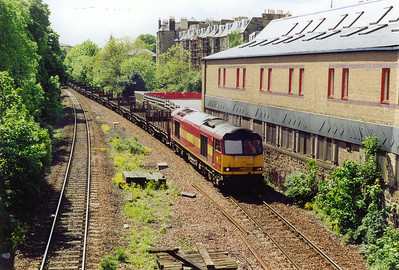Mike and I were originally in the carpark visible above the rear cab of 60010. When we heard it coming we ran round to the gate that used to lead down to the station. The tug is working 6E30 1329 Dalzell to Lackenby steel empties. This is a heavy daily train when running loaded.