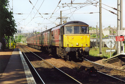Virgin liveried 86244 clatters over the turnout onto Craiglockhart loop and the Sub at Slateford station. It is bound for Birmingham New Street from Edinburgh, 1710 off, headcode 1M35.