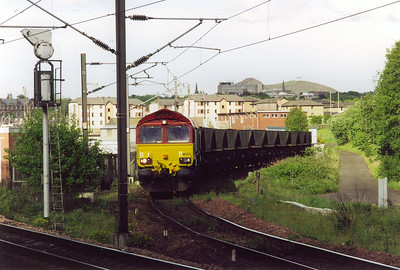 An empty MGR train comes off the loop and approaches the main line behind 66222 with an unknown working. This loco landed at Newport Docks around four weeks previously and the drivers seat in the rear cab still had the plastic covering on it.