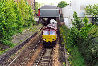 Moving to the select area of Edinburgh at Morningside and 66153 rumbles through the closed station with the daily 6D38 1242 Oxwellmains to Viewpark loaded cement tanks.