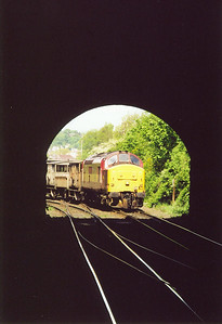 37405 comes off the Craiglockhart loop at Craiglockhart Junction and will pass through the 60 yard tunnel beneath the Union Canal. It is hauling a short engineers train back to Millerhill and is viewed from the platform of the closed Craiglockhart station.