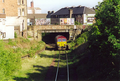 Turning round on the pedestrian bridge over the line and 66177 passes the platforms of Easter Road station. The curving platform to the left ran round to Abbeyhill and a junction with the main line just south of Carlton Hill Tunnels.