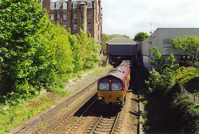The sun has come out as we see 66126 for the second time of the day. It powers a rake of empty coal hoppers as 6D70 1340 FX Millerhill to Mossend. Only the anticlockwise platform remains at this former station.