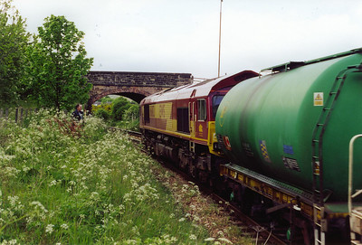 Friend Mike lurks in the dense undergrowth of Duddingston station platforms as 66182 passes with more than just one TTA tank in tow. 6G45 is the 1038 Millerhill to Longannet and Thornton Enterprise working. The fuel tank is for the stabling point at Thornton and in fact this is the train which 66126 brought into Millerhill a short time earlier.