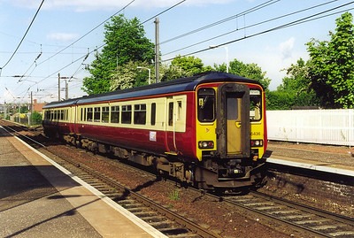 Strathclyde PTE have chosen Carmine and Cream for their new livery and it suits the class 156 really well. 156436 slows for its station stop in full sun whilst working 2Y77 1721 local from Edinburgh to Motherwell.