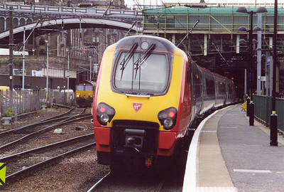 The doyen of the Voyager fleet, 220001 sits in platorm 10 with a long distance Cross Country service to Brighton, 1040 off with the headcode 1O40. To the left is 66208.