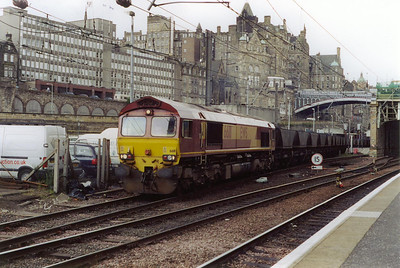 66111 works east with 7B47 1053 Mossend to Millerhill loaded MGR. It seems that freight is being put through both platform 19 and, as in this case, the Suburban platforms, 20 and 21.