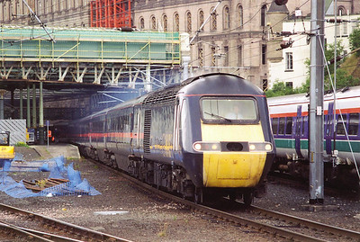 GNER's longest distance working is the daily Inverness to Kings Cross and its balancing service. The Highland Chieftain runs for 580 miles and is booked for an HST. 43112 leads the train away from Edinburgh having made its station stop in platform 19. The run to London is wholly under the wires.
