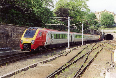 A pair of Virgin Voyager units depart Edinburgh at 0910 with 1O38 to Bournemouth via the West Coast.  The sets are 220011 and 220027.