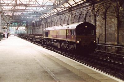 Due to engineering work being carried out on the Edinburgh Suburban Lines all freight was being routed through Waverley station. 66133 stands on one of the through roads beside platform10/11 with a late running train of steel slabs for Dalzell steel works.