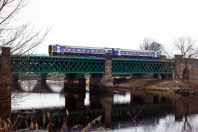 This structure was refurbished with the rebuilding of the Alloa route and an unknown class 158 Sprinter crosses the Caledonian Railway built viaduct with 2N60 1341 from Alloa to Glasgow Queen Street.
