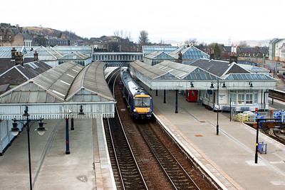 Stirling's large and very impressive Caledonian Railway built station was constructed in 1915 by James Miller and is now a Category A listed building. 170395 is almost lost within the glass canopy's as it makes its station stop with 1T22 1242 Aberdeen to Glasgow Queen Street.