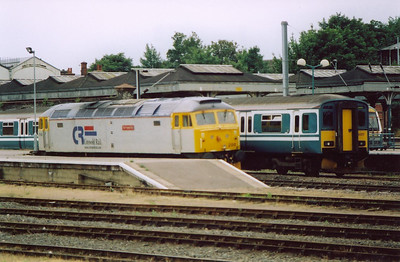 Norwich station and Cotswold Rail 47200 is stabled beside Anglia liveried 150217.  18/7/2004.