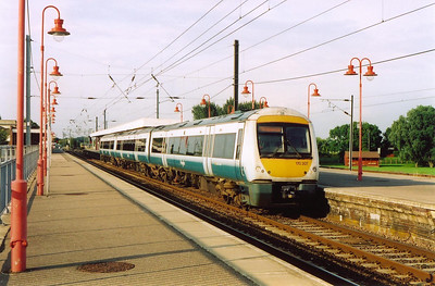 Anglia liveried 170207 slips away from Ely in the evening sunlight with 1H53 1746 Norwich to Cambridge service.