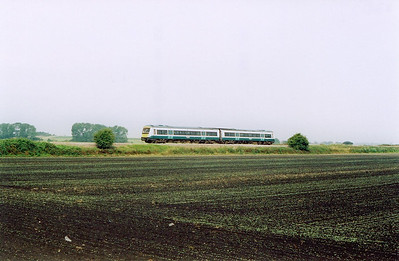 The next day and I had hoped to see a freightliner working at this spot, Blockmoor Fen on the line from Ely to Stowmarket via Bury St Edmunds. This working is 1L36 0845 Peterborough to Ipswich formed by an unknown class 170 Turbostar.  20/7/2004