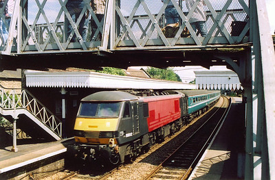 On the back of the train is the electric loco, 90012 in former Virgin red livery.
