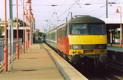 Turning round and on the rear of the train is 90027.