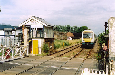 The signalbox at Lakenheath is like the others on this line, small and beside the level crossing. 170206 approaches in the up direction with 1H49 1526 Norwich to Cambridge.