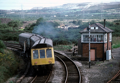 With the China clay tips dominating the background, the Newquay branch DMU heads awau from St Dennis 6/9/85