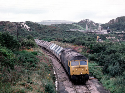 47284 arriving at Parckandillack.  In the background is the Parckandillack china clay works, still with an intact Beam engine. 3/9/85