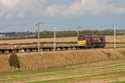 66186 hauls a rake of empty cartics as 6M85 1308 Bathgate to Washwood Heath empty car flats and is running about an hour late.