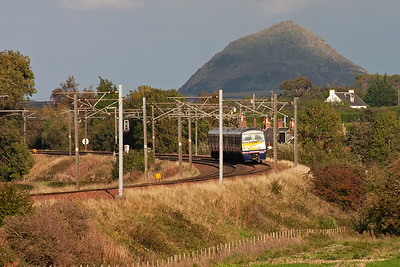 A class 2 local working leans well into the curve with EMU 322481 forming 2Y07 1520 North Berwick to Edinburgh all stations stopper.  The sun is starting to light up the Law which is a volcanic plug.