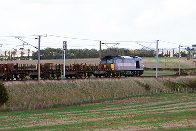 The train is made up of around 15-20 BDA steel slab carriers.  Due to the weight of the loaded train this is a class 60 turn.
