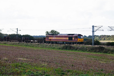 A few minutes after 66186 goes by we are treated to another freight.  60097 leads 6E30 1333 Dalzell to Lackenby empty steel carriers.