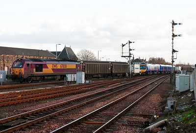 The reason for being on a cold but sunny Stirling platform arrives. 67030 leads 6X79 1448 Mossend to Stirling conveying Desiro unit 185138 coupled between a pair of FIA container flats and ferry vans.