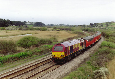 A move to Marizion, about 2 miles from Penzance and 67025 approaches with 5C01 1600 from St Blazey to Penzance empty TPO.  On arrival it will reverse back to Long Rock Depot, run round, and then reverse again back to the station.  Then it will head for Bristol Parkway at 1930 as 1C01.