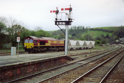66078 runs into Lostwithiel with a short rake of four empty CDA hoppers from the Carne Point loading terminal at Fowey Docks.  It will run round them and head onto St Blazey.  16/4/2002