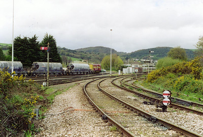 St Blazey yard pilot 08499 is busy and goes about its business shunting Imerys china clay tanks.  Visible is St Blazey signalbox and the platform of the former station here which closed to the public on 21/9/1925 but remained open for workmen till 29/12/1934.