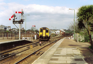 The lower of the two signals denotes the less important of the two routes available. In this case it is the signal for access to the St Ives branch. The driver proceeds slowly so he can collect the token from the signalman.