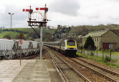 43042 leads the 1155 Penzance to Liskeard shuttle service past the down starting gantry at Lostwithiel. At Liskeard passengers were being bussed to and from Plymouth.  The building on the right is the former broad gauge good shed.
