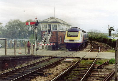 Back on time and bound for London, 43041 powers past the signalbox with the up starter already put back. The train is due at Paddington at 1900.