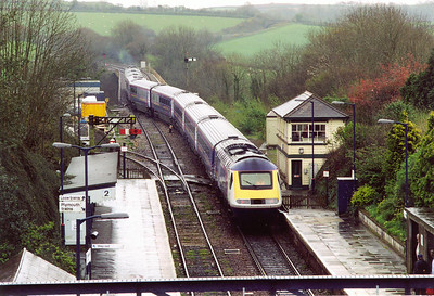 Due to engineering works over the Easter weekend, the Royal Albert Bridge was closed and a shuttle service was operated between Liskeard and Penzance. 43140 and 43165 cross from the up to the down road.  The signalman is having a busy day.  14/4/2002
