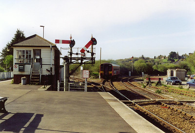 Bubblecar 153318 slips away with the first train of the day to Newquay, 2B53 0933 off Par.
