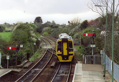 The sun has gone as 158858 arrives at St Erth with 1B71 1630 Penzance to Cardiff Central. The down starter on the up road allows a train off the St Ives branch to depart west and take the crossover just off the end of the platform.